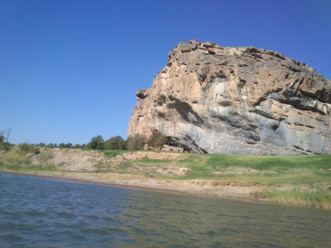 A house built almost underneath the rocks on the South African side of the Orange river